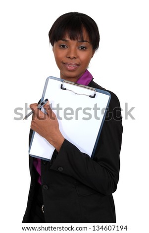 Woman holding a clipboard - stock photo