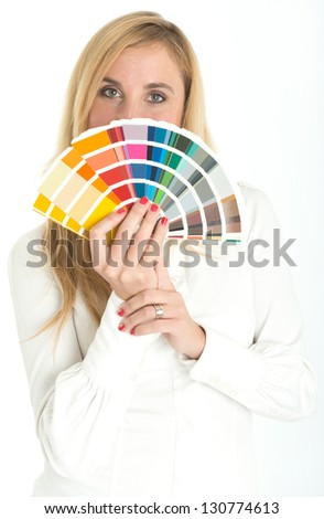Woman holding a color swatch