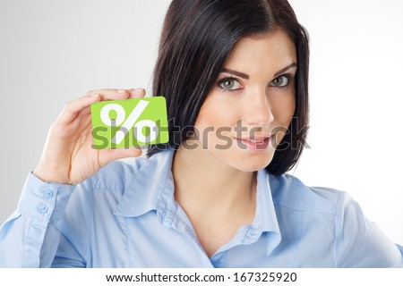 woman holding a credit card - stock photo