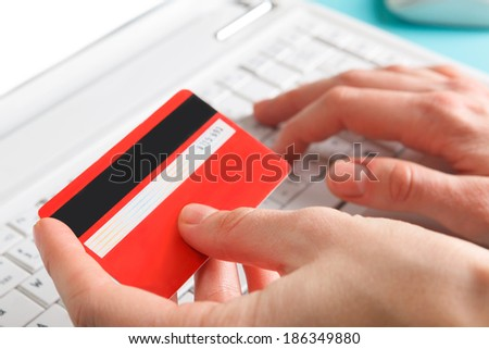 Woman holding a credit card for online shopping. - stock photo