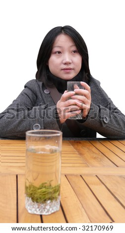 woman holding a cup of tea - stock photo