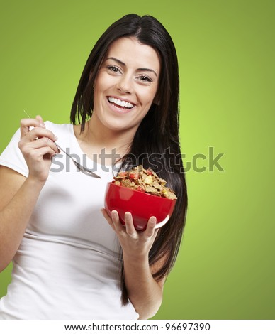 woman holding a delicious red breakfast bowl against a green removable chroma background background background - stock photo