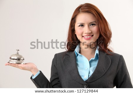 woman holding a desk bell - stock photo