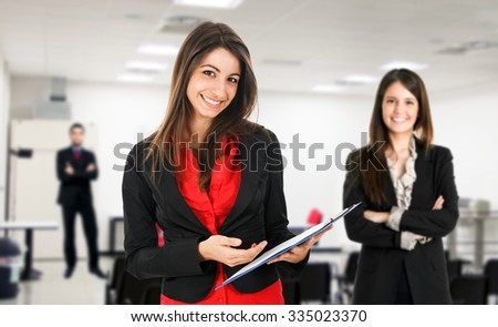 Woman holding a document - stock photo