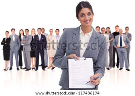 Woman holding a form against - stock photo