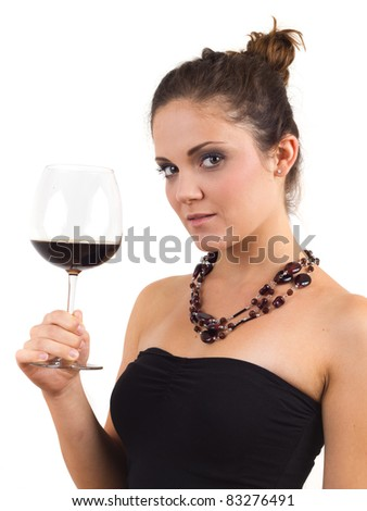 Woman holding a glass of wine - stock photo