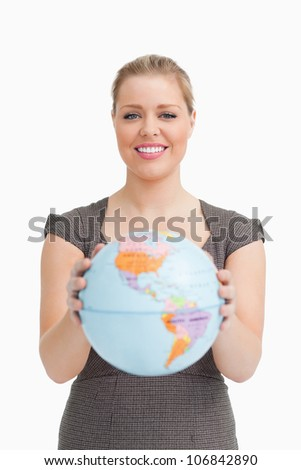 Woman holding a globe against white background - stock photo