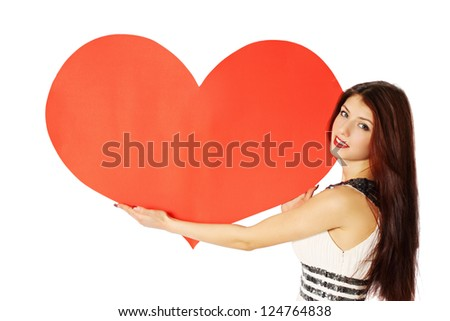 woman holding a heart on Valentine's Day - stock photo