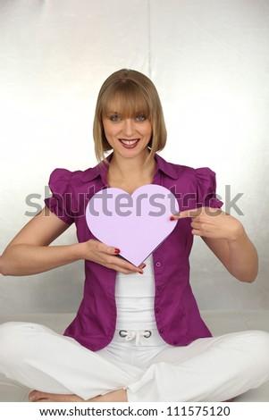 woman holding a hearth shaped box - stock photo