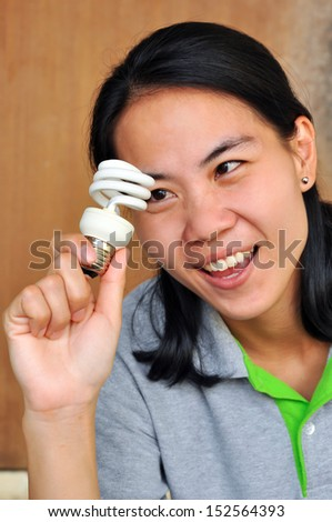 Woman holding a lamp in her hands with happiness