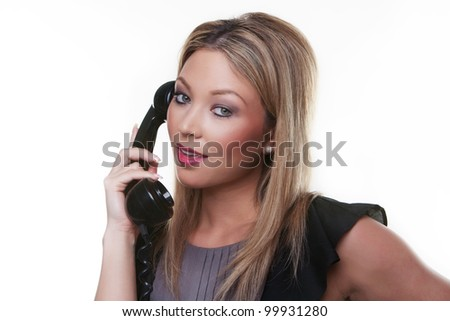 woman holding a land line phone