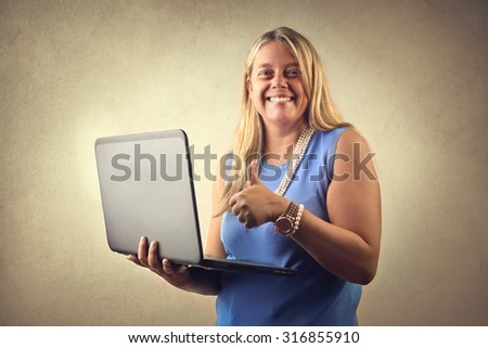 Woman holding a laptop - stock photo