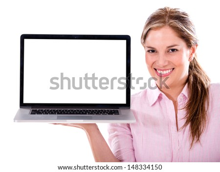 Woman holding a laptop computer and displaying the screen - isolated - stock photo