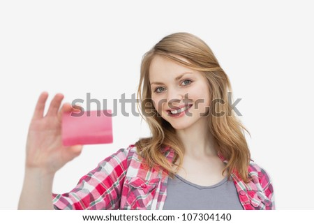 Woman holding a loyalty card against a white background - stock photo