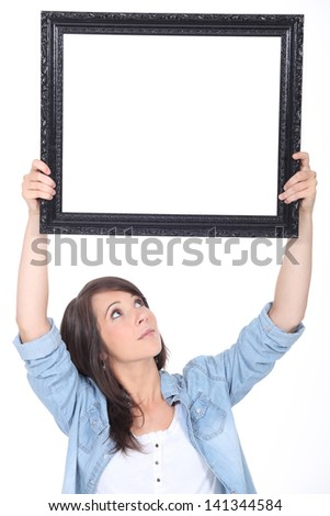 woman holding a mirror - stock photo