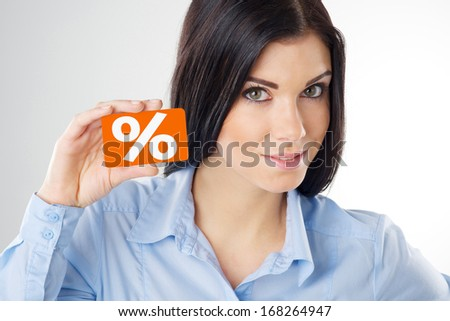 woman holding a orange card