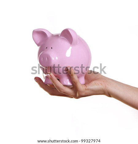Woman holding a pink piggy bank. - stock photo