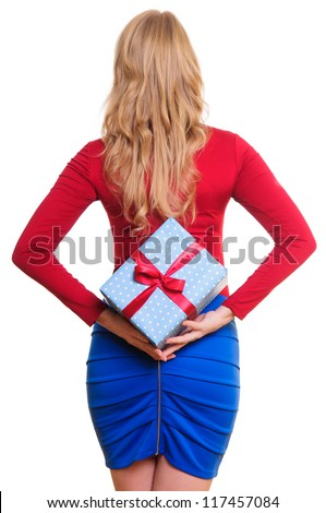 woman holding a present on her back. isolated on white background