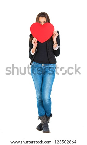 Woman holding a red heart - stock photo