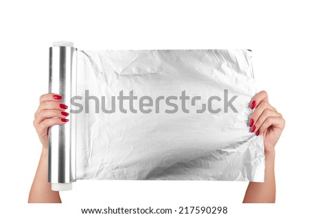 woman holding a roll of aluminum foil  - stock photo