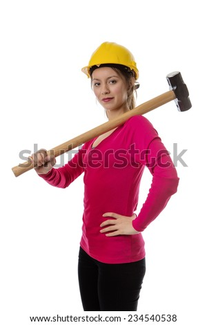 woman holding a sledgehammer and wearing a hard hat about to smash something - stock photo