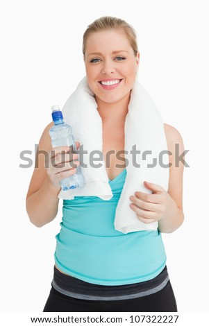 Woman holding a towel around her neck against white background