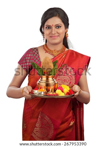 Woman holding a traditional Diwali thali, religious offering and smiling - stock photo