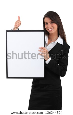 woman holding a white board - stock photo
