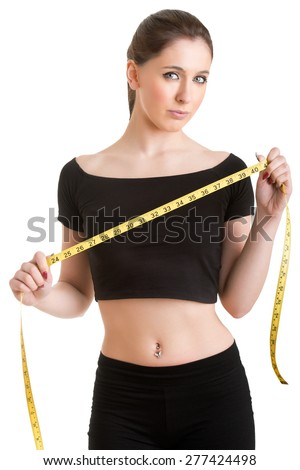 Woman holding a yellow measuring tape, isolated in white - stock photo