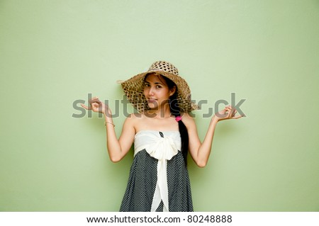Woman holding action on green background