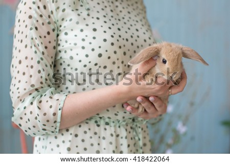 woman holding an Easter bunny - stock photo