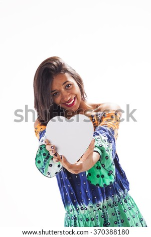 Woman holding an heart shape - stock photo