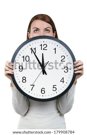 Woman holding an office clock isolated on a white background. Time concept - stock photo
