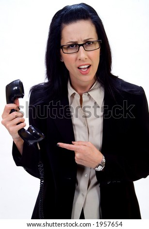 Woman holding an old school phone pointing finger - stock photo