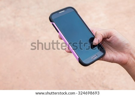 woman holding and touch screen of smart phone.