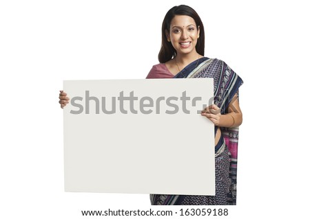 Woman holding at a whiteboard and smiling - stock photo