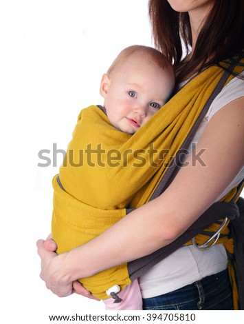 Woman holding baby yellow in sling