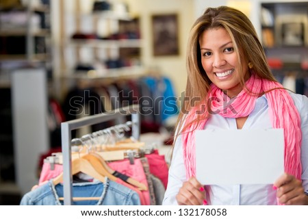 Woman holding banner at a clothing store - stock photo