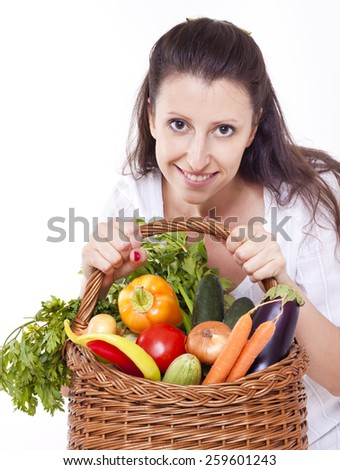 Woman holding basket full of vegetables
