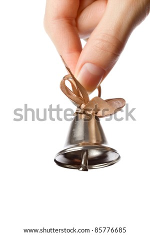 Woman holding bell in the hand - stock photo