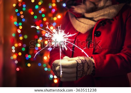 Woman holding bengal lights over bokeh background. Christmas concept. - stock photo