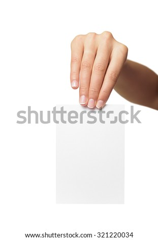 Woman holding blank business card in hand. Isolated on white.