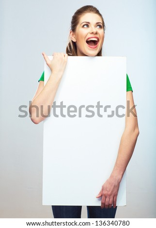 Woman holding blank poster isolated studio portrait. - stock photo