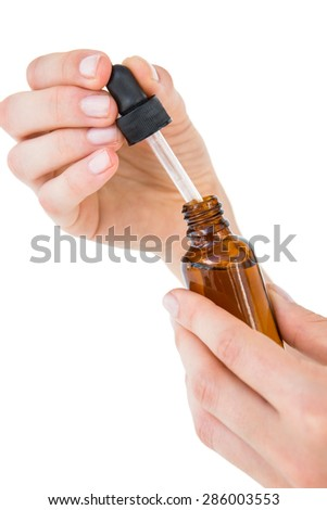 Woman holding bottle of medicine on white background