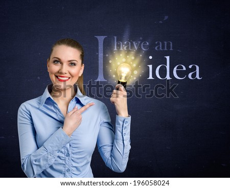 Woman holding bright bulb, concept - I have an idea - stock photo