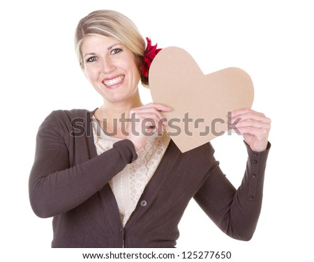 woman holding brown vintage heart close-up isolated on white