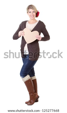 woman holding brown vintage heart full length isolated on white - stock photo