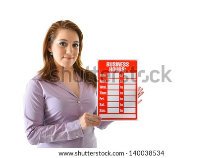 "Woman holding ""business hours"" sign - stock photo"