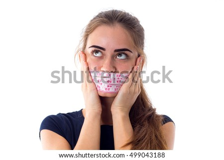 Woman holding centimeter around her mouth