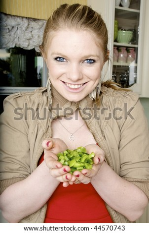 Woman Holding Chopped Green Peppers in Her Hands